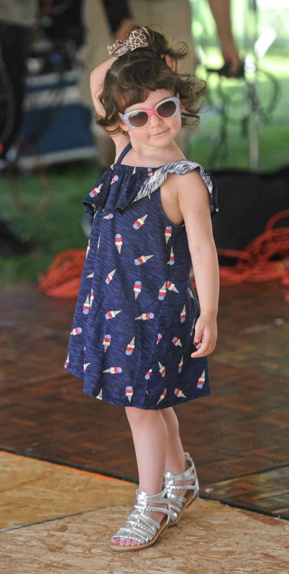 Victoria LoGuidice, 2, dances to the music at the annual Italian Festival at the Amerigo Vespucci Lodge on Christopher Columbus Avenue on Saturday, August 5, 2017, in Danbury, Conn. The festival continues on Sunday from 1 to 9 p.m.