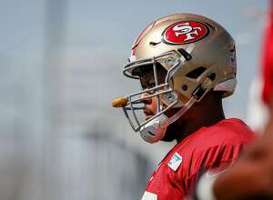 Sa Fransisco 49ers offensive lineman Joshua Garnett (65) warms up before practice on the practice field in Levis Stadium in Santa Clara on Wednesday, August 2, 2017.
