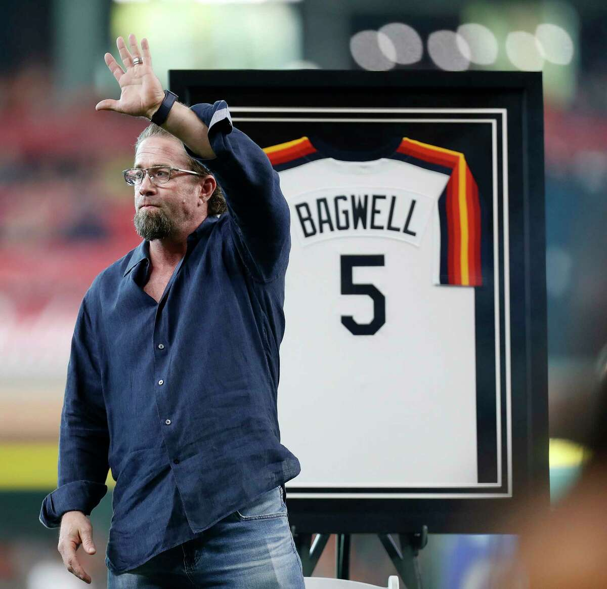 Jeff Bagwell waves to fans during a ceremony to honor his recent induction into the National Baseball Hall of Fame before the start of an MLB game at Minute Maid Park, Saturday, Aug. 5, 2017, in Houston.