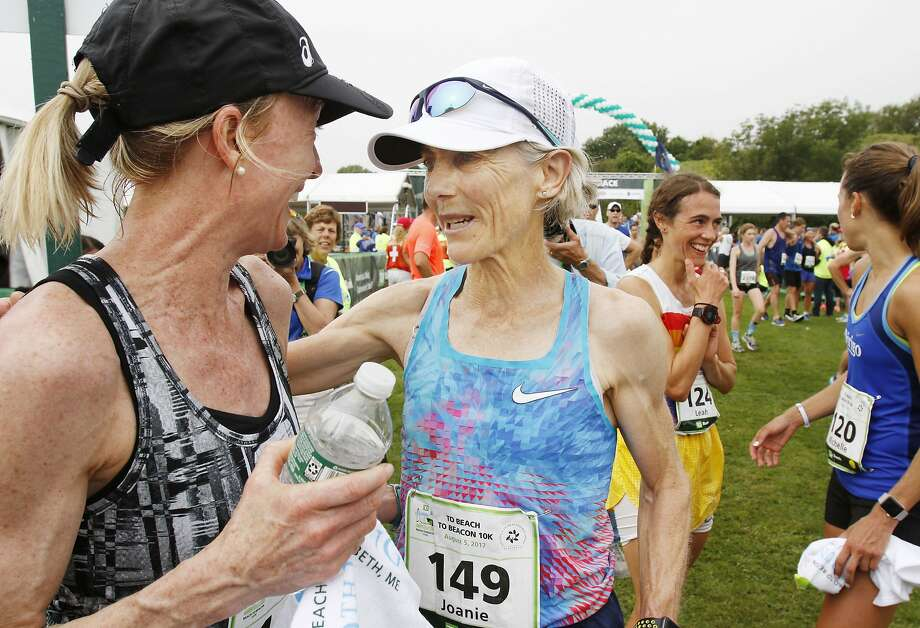 Joan Benoit Samuelson (right) greets Deena Kastor at the Beach To Beacon 10K race. Photo: Joel Page, Associated Press