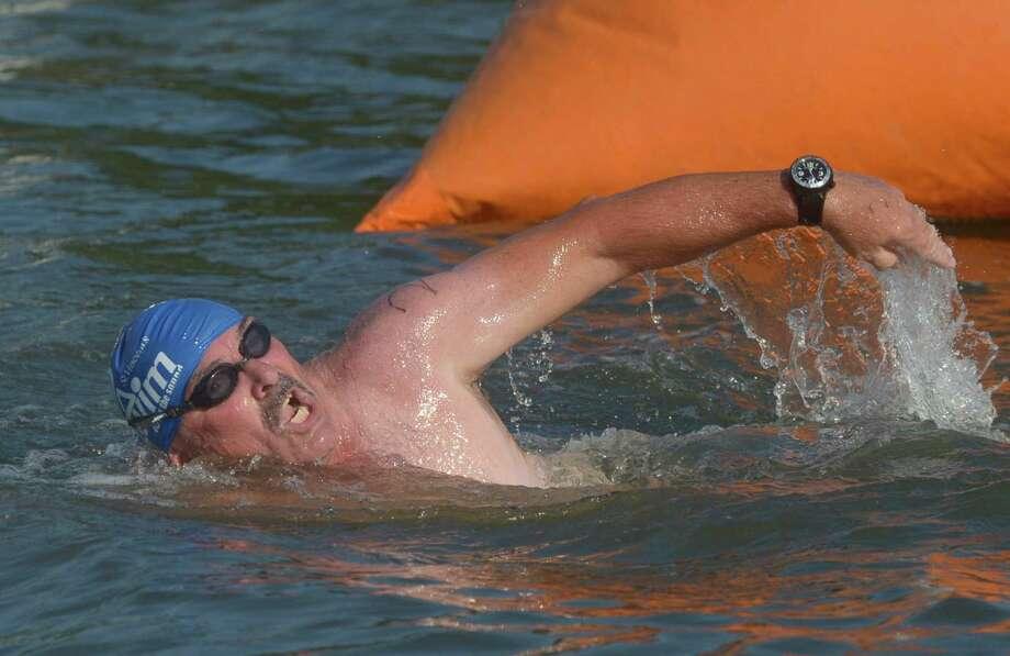 Cancer survivor Tom Casey leads his team, Team K-Sea, to the finish. Photo: Erik Trautmann / Hearst Connecticut Media / Connecticut Post