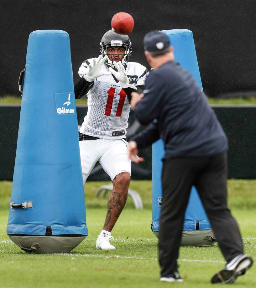 Jaelen Strong, who hauls in a pass from Texans wide receivers coach John Perry, has been working hard in a bid to fill the void created by injuries to Will Fuller and DeAndrew White. Photo: Brett Coomer, Staff / © 2017 Houston Chronicle}