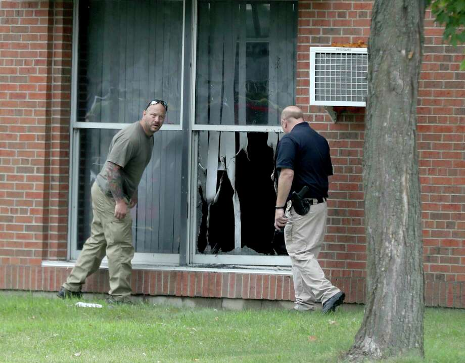 Officials investigate an explosion at the Dar Al-Farooq Islamic Center in Bloomington, Minn., on Saturday. No one was injured in the blast.  Photo: David Joles, MBO / Star Tribune