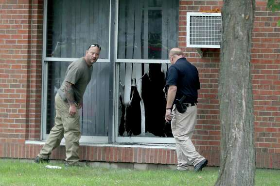 Officials investigate an explosion at the Dar Al-Farooq Islamic Center in Bloomington, Minn., on Saturday. No one was injured in the blast.