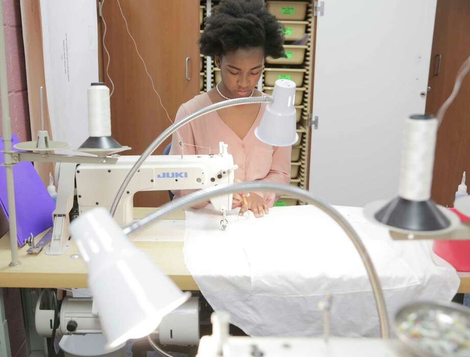 Mekayla Hughes, a Cypress Ridge junior, sews sleeping bag liners for NASA that will be sent to the International Space Station for American astronauts. Hughes plans to study fashion design and merchandising after high school.  Photo: Elizabeth Conley, Staff / © 2017 Houston Chronicle