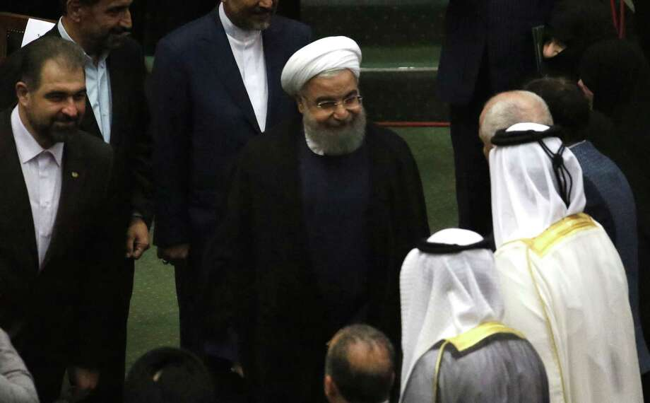 Iran's President Hassan Rouhani (C) greets visitors after being sworn in before parliament in Tehran, on August 5, 2017. Rouhani warned the US against tearing up the nuclear deal as he was inaugurated for a second term, but he also faces challenges closer to home amid accusations he is rolling over to conservatives. / AFP PHOTO / ATTA KENAREATTA KENARE/AFP/Getty Images Photo: ATTA KENARE, Contributor / AFP or licensors