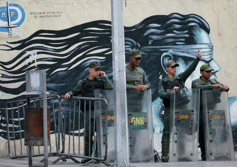 Venezuelan Bolivarian National Guards officers lineup outside of General Prosecutor headquarters in Caracas, Venezuela, Saturday, Aug. 5, 2017. Security forces surrounded the entrance to Venezuela's chief prosecutor's office early Saturday ahead of a session of the newly-installed constitutional assembly in which the pro-government body is expected to debate the onetime loyalist turned arch critic's removal. (AP Photo/Ariana Cubillos) Photo: Ariana Cubillos, STF / Copyright 2017 The Associated Press. All rights reserved.