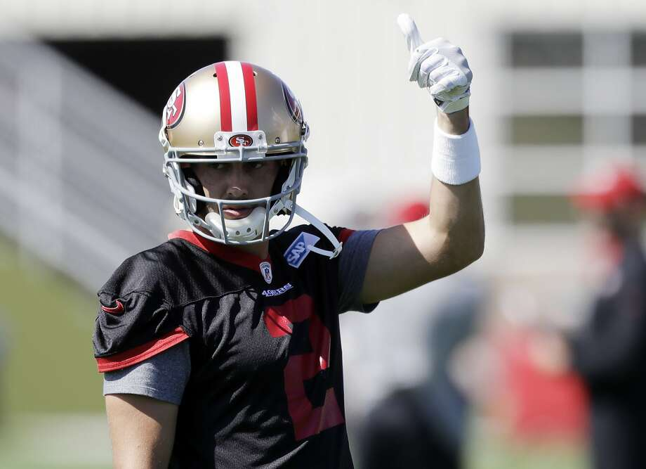 FILE – San Francisco 49ers quarterback Brian Hoyer signals during the NFL team's football training camp Friday, July 28, 2017, in Santa Clara. Hoyer impressed crowds at the 49ers practice on Saturday. Photo: Marcio Jose Sanchez, Associated Press