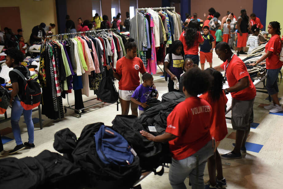 "FILE PHOTO: Families gather clothes and school items during a free event called ""Community Fest"" hosted by Community Worship Center on Aug. 5, 2017, at the Martin Luther King Center. The event supplies families with school uniforms and other clothes for free. James Durbin/Reporter-Telegram Photo: James Durbin"