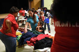 "Families gather clothes and school items during a free event called ""Community Fest"" hosted by Community Worship Center on Aug. 5, 2017, at the Martin Luther King Center. The event supplies families with school uniforms and other clothes for free. James Durbin/Reporter-Telegram"