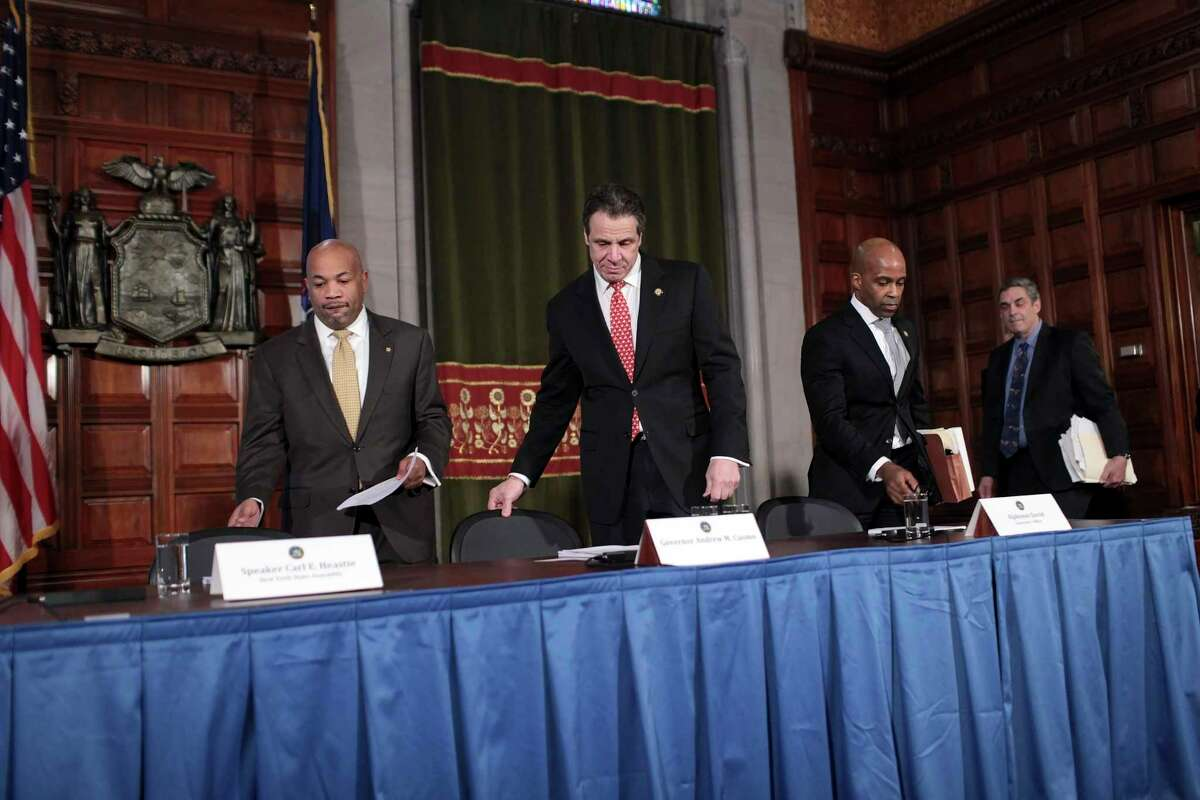 Gov. Andrew Cuomo arrives for a news conference on ethics reform at the State Capitol in Albany, N.Y., March 18, 2015. Though Gov. Andrew M. Cuomo made expanding oversight of public officials a centerpiece of his agenda this year, the state?'s has not allocated any additional money to do so. From left: Assembly Speaker Carl E. Heastie, Cuomo, Alphonso David and Jim Yates.(Nathaniel Brooks/The New York Times) ORG XMIT: XNYT100
