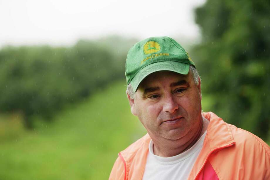 Jeremy Knight, owner of Knight Orchards, stands in an area of his orchard on Tuesday, July 25, 2017, in Ballston, N.Y.  In early 2000 Knight had to remove roughly 200 apple trees from this area.  The trees had died because of poor water drainage, something Knight said was never an issue until a housing development was built near his orchard.   (Paul Buckowski / Times Union) Photo: PAUL BUCKOWSKI / 20041093A