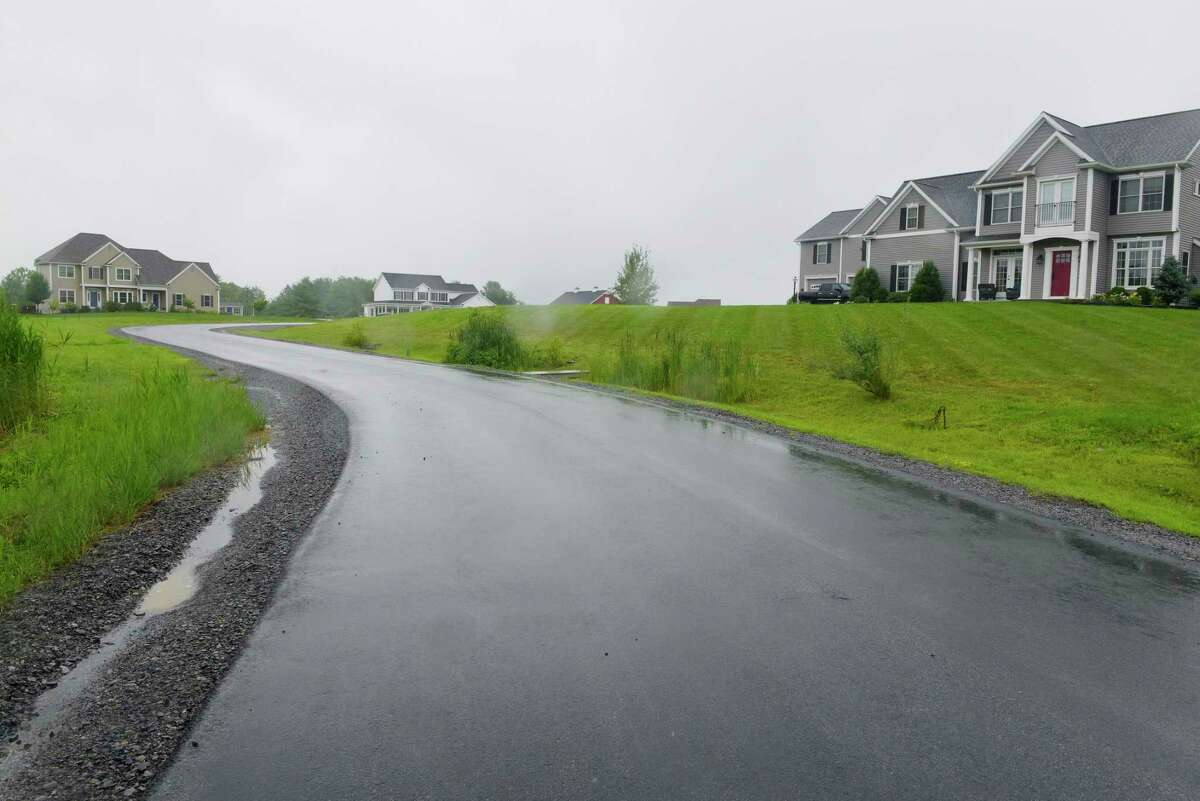A view of the West Wind Farm housing development on Tuesday, July 25, 2017, in Ballston, N.Y. Town Board member Kelly Stewart said, despite what the state Department of Agriculture and Markets is investigating, West Wind (which was built by her husband) did legally hook up to public water in an agricultural district. (Paul Buckowski / Times Union)