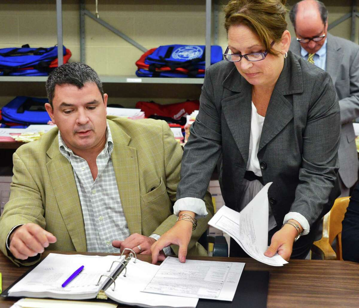 James Walsh, left, and Saratoga County Board of Elections clerk Donna Gunderson seen during a count of absentee ballots in September 2013 in Ballston Spa. Walsh in 2017 is both representing the town of Ballston in a lawsuit brought by the state Department of Agriculture and Markets and is Ballston GOP chairman. Walsh said there is no conflict of interest. (John Carl D'Annibale / Times Union)