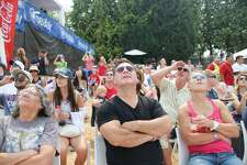 Spectators watch the U.S. Navy Blue Angels fly during the Boeing Seafair Air Show at Seafair, August 5, 2017.