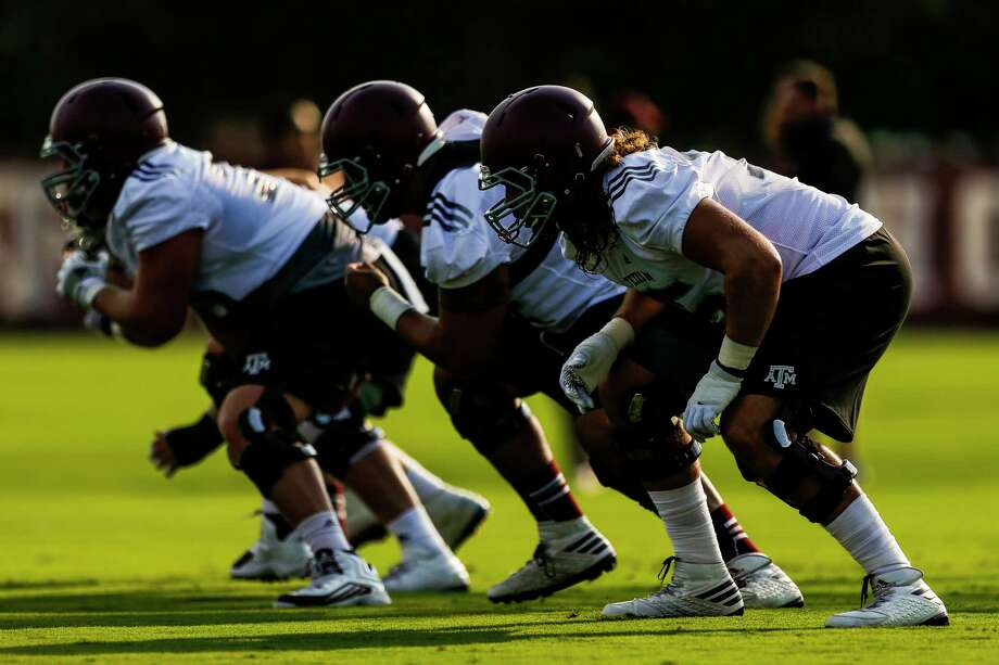 Texas A&M junior Koda Martin, right, is expected to be the leader of an offensive line without any senior starters. Photo: Michael Ciaglo, Staff / Michael Ciaglo