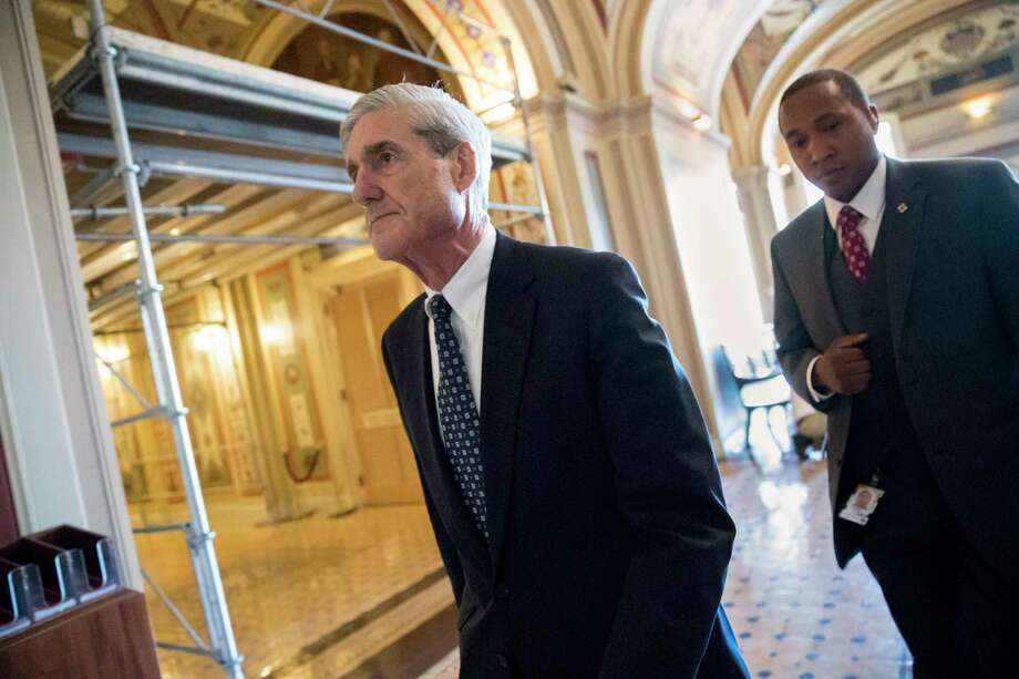 FILE - In this June 21, 2017 file photo, special counsel Robert Mueller departs after a closed-door meeting with members of the Senate Judiciary Committee about Russian meddling in the election and possible connection to the Trump campaign, on Capitol Hill in Washington. In populist tones, President Donald Trump is trying to turn the investigation into his campaign's ties to Russia into a rallying cry, labeling it as an existential threat to the loyal base that fueled his surprise 2016 election triumph. (AP Photo/J. Scott Applewhite, File) ORG XMIT: WX205 Photo: J. Scott Applewhite / Copyright 2017 The Associated Press. All rights reserved.
