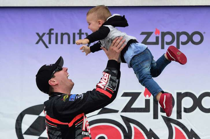 Kyle Busch celebrates in victory lane with his son, Brexton, after winning the Xfinity Series race Saturday at Watkins Glen International.