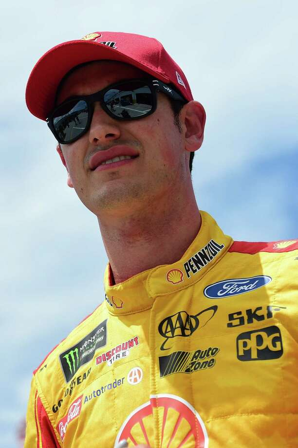 DAYTONA BEACH, FL - JUNE 29:  Joey Logano, driver of the #22 Shell Pennzoil Ford, walks through the garage area during practice for the Monster Energy NASCAR Cup Series 59th Annual Coke Zero 400 Powered By Coca-Cola at Daytona International Speedway on June 29, 2017 in Daytona Beach, Florida.  (Photo by Jared C. Tilton/Getty Images) ORG XMIT: 691600987 Photo: Jared C. Tilton / 2017 Getty Images