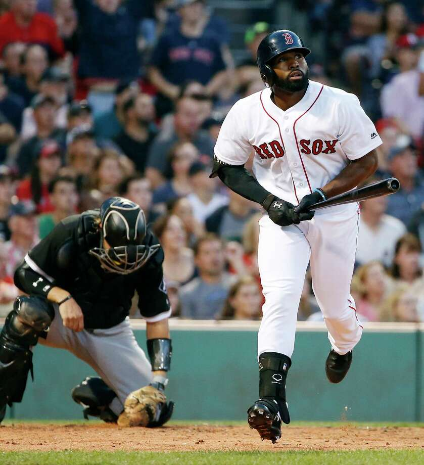 Boston Red Sox's Jackie Bradley Jr., right, watches his two-run home run in front of Chicago White Sox catcher Kevan Smith during the second inning of a baseball game in Boston, Saturday, Aug. 5, 2017. (AP Photo/Michael Dwyer) ORG XMIT: MAMD107 Photo: Michael Dwyer / AP2017