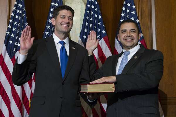 House Speaker Paul Ryan of Wis. administers the House oath of office to Rep. Henry Cuellar, D-Texas, during a mock swearing in ceremony on Capitol Hill in Washington, Tuesday, Jan. 3, 2017, as the 115th Congress began.