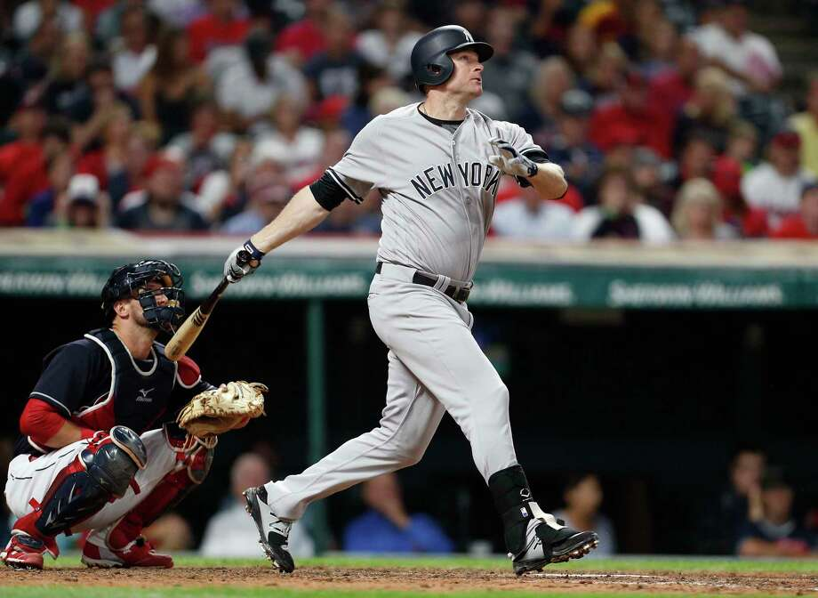 CLEVELAND, OH - AUGUST 04:  Chase Headley #12 of the New York Yankees hits a solo home run against the Cleveland Indians the eighth inning  at Progressive Field on August 5, 2017 in Cleveland,  Ohio.  The Yankees defeated the Indians 2-1.   (Photo by David Maxwell/Getty Images) ORG XMIT: 700011909 Photo: David Maxwell / 2017 Getty Images