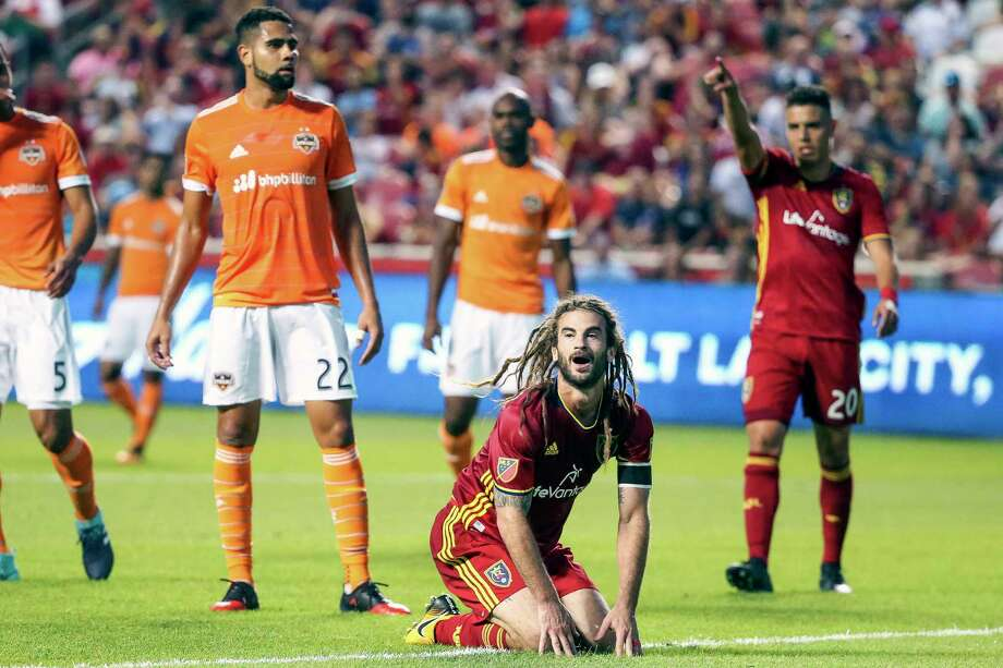 Real Salt Lake midfielder Kyle Beckerman, front, reacts to a close attempt on goal during an MLS soccer match against the Houston Dynamo  at Rio Tinto Stadium in Sandy, Utah, Saturday, Aug. 5, 2017. (Spenser Heaps/The Deseret News via AP) Photo: Spenser Heaps, Associated Press / The Deseret News