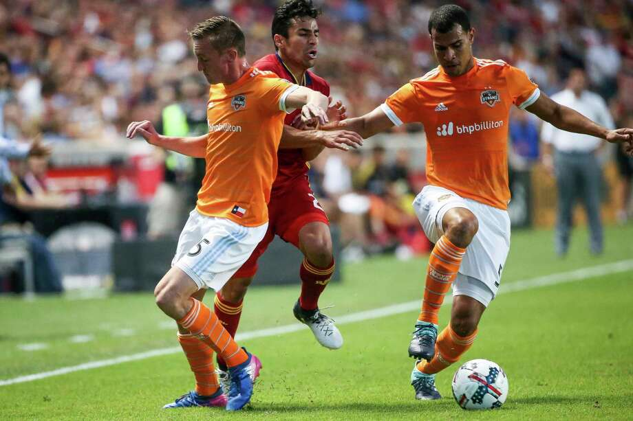 Real Salt Lake defender Tony Beltran (2) moves between Houston Dynamo defender Dylan Remick (15) and midfielder Juan David Cabezas (5) during an MLS soccer match at Rio Tinto Stadium in Sandy, Utah, Saturday, Aug. 5, 2017. (Spenser Heaps/The Deseret News via AP) Photo: Spenser Heaps, Associated Press / The Deseret News