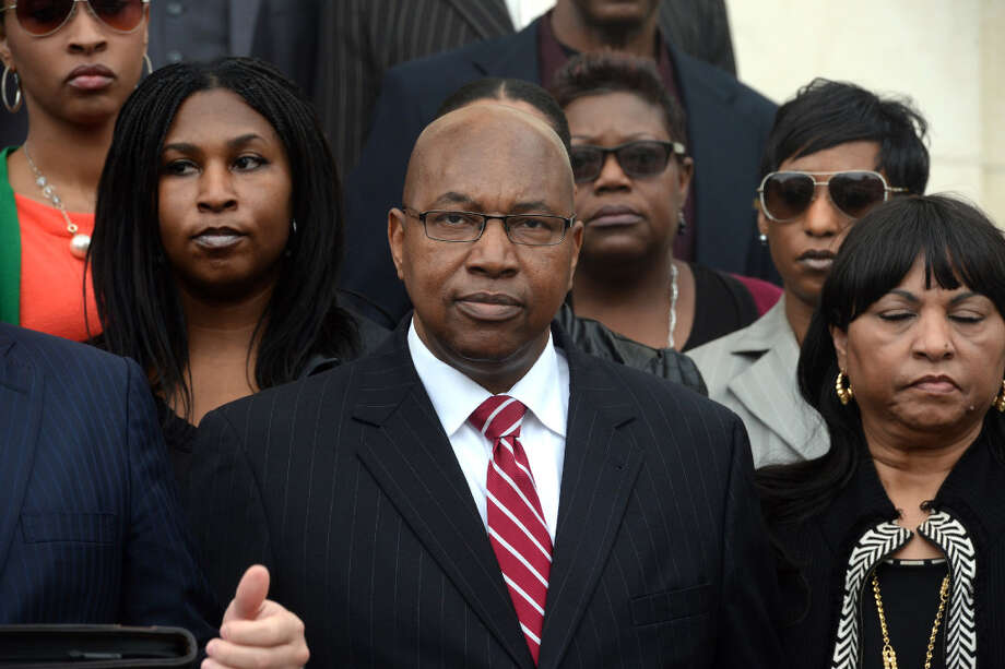 WalterDiggles, center, the Executive Director of the Deep East Texas Council of Governments, his wife RosieDiggles, right and daughter AnitaDiggles, left, are named in a federal indictment stemming from the FBI's 2014 raid of the DETCOG offices. Photo taken during a press conference at the Federal Courthouse on Monday. Photo taken Monday, Dec. 21, 2015. Photo: Guiseppe Barranco/Hearst