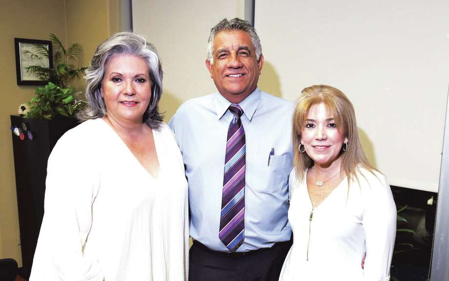 Laura Aguero, Carlos Mendoza and Patty Garcia-Diaz at Legend Title & Abstract annual Mexican Fiesta. Photo: Courtesy