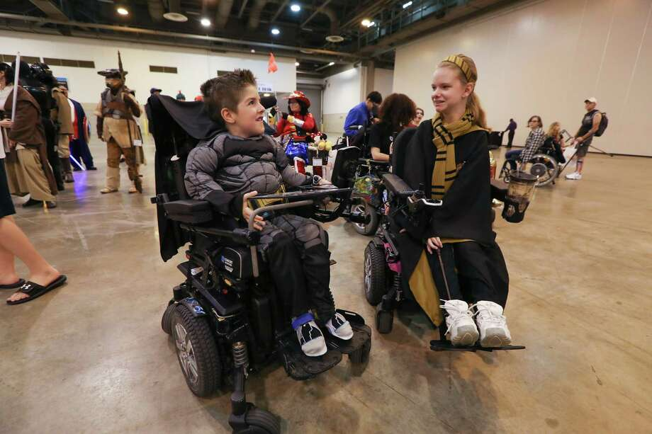 Cooper Somers, 7, (left), Batman, talks to Chloe Short, 14, Hermione from Harry Potter, before the CosAbility a Mock Cosplay Competition, Saturday, Aug. 5, 2017, in Houston. The event encouraged participates to dress as their favorite character and show off your best cosplay costumes. Abilities Expo at NRG Center through Sunday. Photo: Steve Gonzales, Houston Chronicle / © 2017 Houston Chronicle