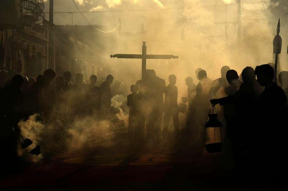 Catholic devotees burn incense during the Jesus de La Merced procession during the celebration of the 300 years of the consecration in Guatemala City on August 5, 2017. Photo: JOHAN ORDONEZ/AFP/Getty Images