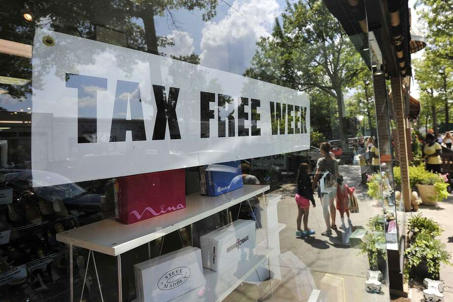 A Greenwich, Conn. store touts Connecticut's 2014 sales tax holiday, scheduled in 2017 for Aug. 20-26 and applying to clothing purchases under $100. Beginning with sales tax permits issued in October 2017, entities that remit sales tax will have to renew those permits every two years, in a state effort to hold accountable any stores in arrears on payments. Prior to the law taking effect, stores renewed permits every five years. Photo: Jason Rearick / Jason Rearick / Stamford Advocate