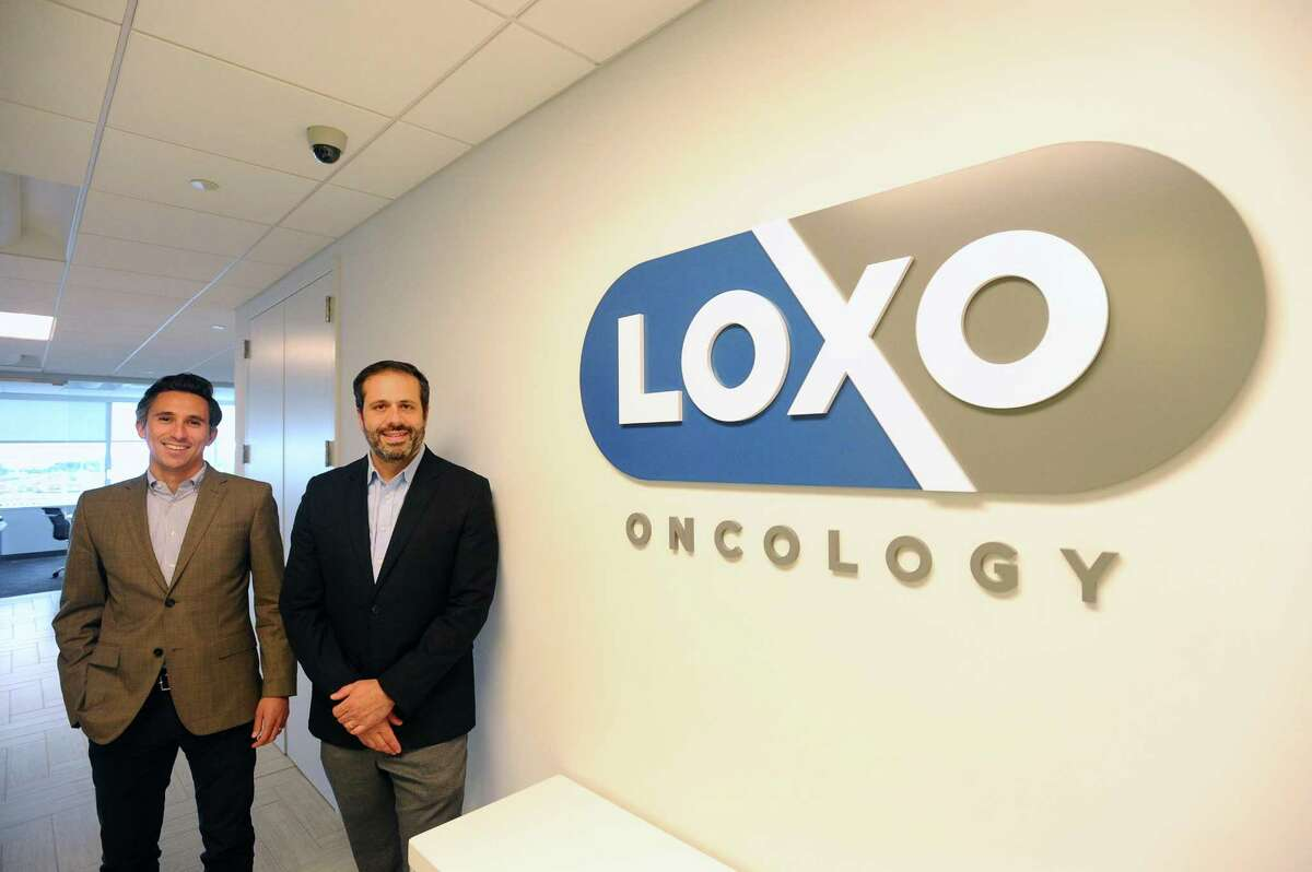 Loxo Oncology CEO Joshua Bilenker, center, and Chief Business Officer Jacob Van Naarden pose for a photo inside Loxo's Tresser Boulevard offices, in downtown Stamford, on Tuesday, July 18, 2017.