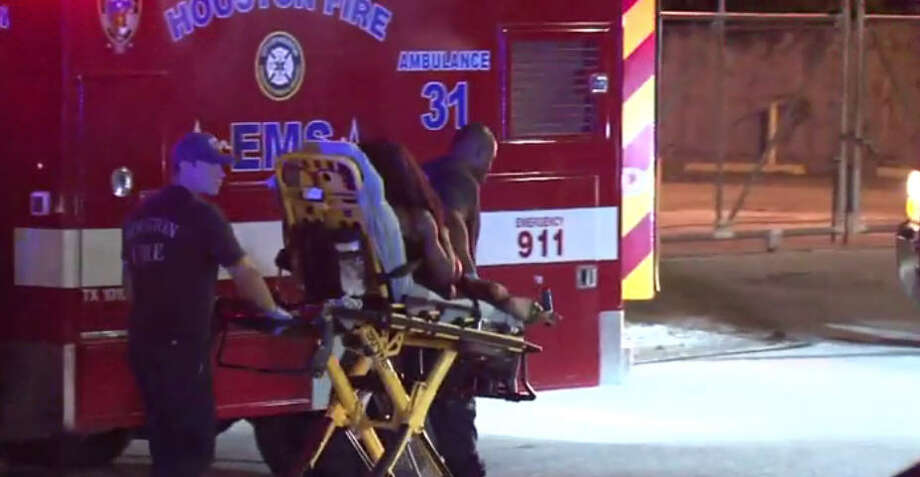 A woman was hospitalized after jumping out of a moving vehicle. Photo: Metro Video