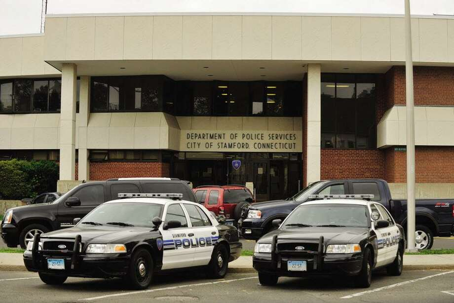 Police cruisers are parked in front of the Stamford police station at 805 Bedford St. The police department is currently running a $271,000 deficit in its overtime account. Photo: Jason Rearick / Jason Rearick / Stamford Advocate