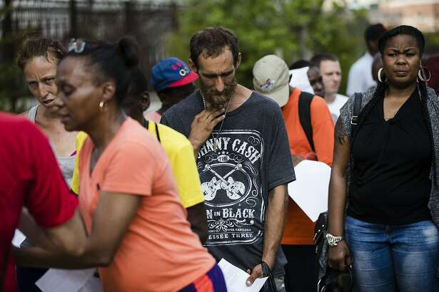 In this Monday, July 24, 2017 photo, Steven Kemp, who is addicted to heroin and is homeless, waits in line for help from a Philly Restart representative to obtain an identification card in Philadelphia, Monday, July 24, 2017. As an opioid epidemic ravages the nation, small but vulnerable populations of homeless people who are seeking respite from their addictions are sometimes turned away from the country's already threadbare system of drug treatment centers because they do not have valid photo identification (AP Photo/Matt Rourke)