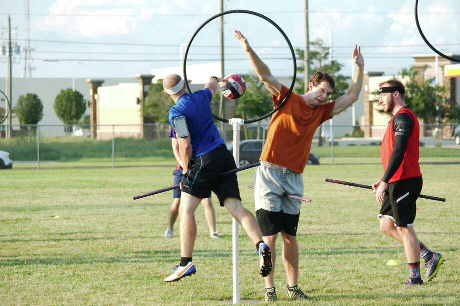 Kevin Raber tosses a score past keeper Andrew McGregor during Quidditch practice in League City in preparation for a national tournamnent to be hosted in the city Aug. 12-13. Photo: Kirk Sides / © 2017 Kirk Sides / Houston Chronicle