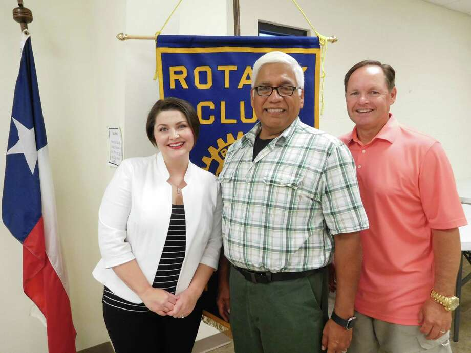 Members of the Cleveland Rotary Club welcomed guest speakers Rolando Leal, Tarkington High School Spanish Teacher and father of 19 adopted children (several sibling groups included), and his daughter Rachel Leal-Hudson, a Family Law Attorney in Kingwood. They spoke about how the family opened their home, and the Cleveland community supported their efforts to give opportunities to the children to have a chance for success.Pictured (left to right) are speakers Rachel Leal-Hudson and Rolando Leal with Rotary President Scott Lambert. Photo: Submitted