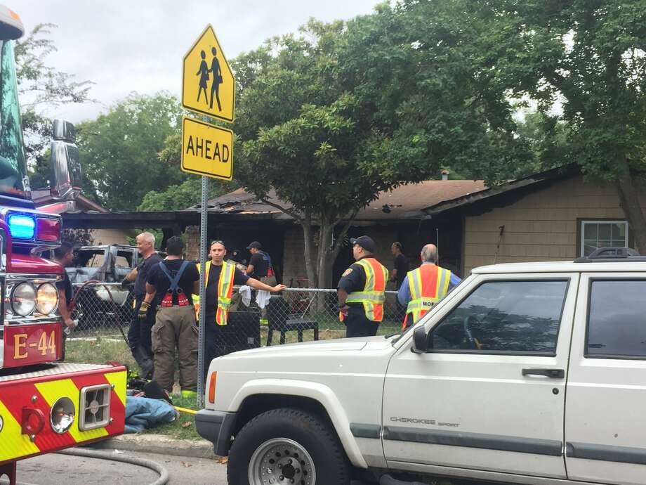 A fire that started in a parked car spread to a residence causing about $50,000 in damages Sunday morning Aug. 6, 2017, on the far West Side. Photo: Nicole Bautista