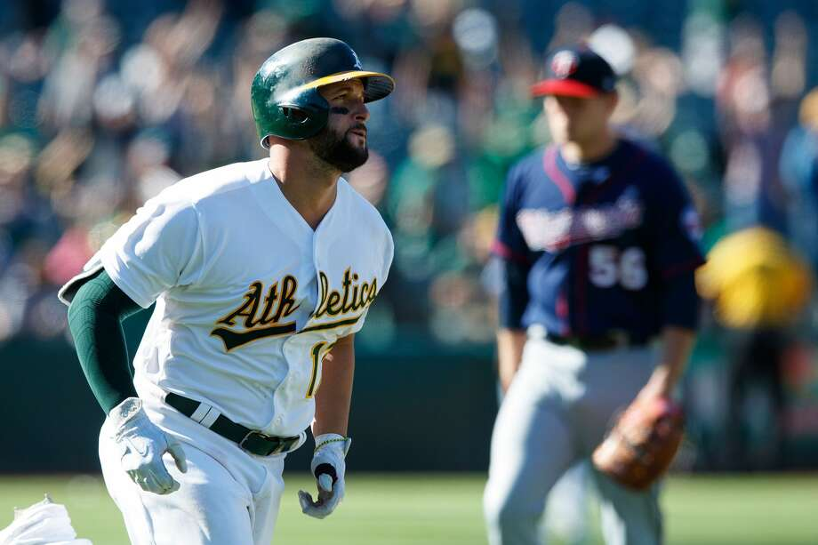 Yonder Alonso #17 of the Oakland Athletics rounds the bases after hitting a walk off home run off of Tyler Duffey #56 of the Minnesota Twins during the twelfth inning at the Oakland Coliseum on July 30, 2017 in Oakland, California. The Oakland Athletics defeated the Minnesota Twins 6-5 in 12 innings. (Photo by Jason O. Watson/Getty Images) Photo: Jason O. Watson/Getty Images