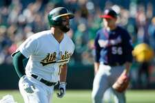 Yonder Alonso #17 of the Oakland Athletics rounds the bases after hitting a walk off home run off of Tyler Duffey #56 of the Minnesota Twins during the twelfth inning at the Oakland Coliseum on July 30, 2017 in Oakland, California. The Oakland Athletics defeated the Minnesota Twins 6-5 in 12 innings. (Photo by Jason O. Watson/Getty Images)