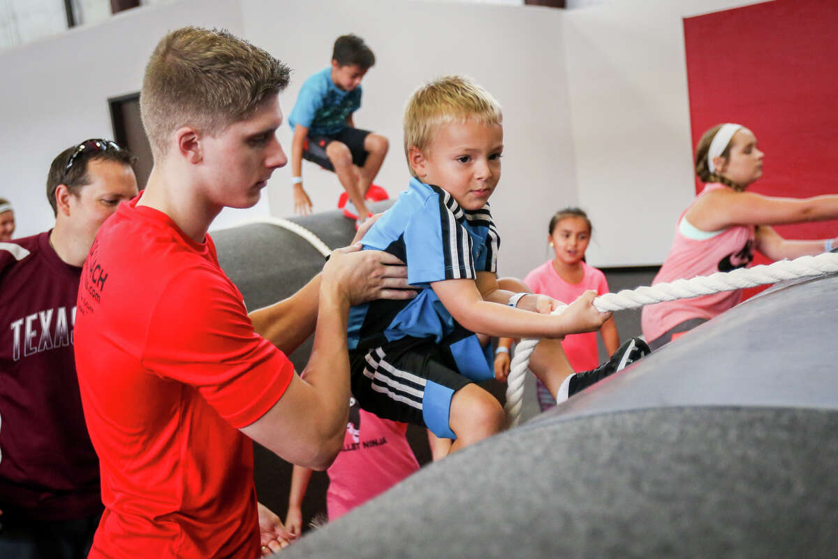 during the grand opening on Saturday, Aug. 5, 2017, at Obstacle Warrior Kids in Spring.