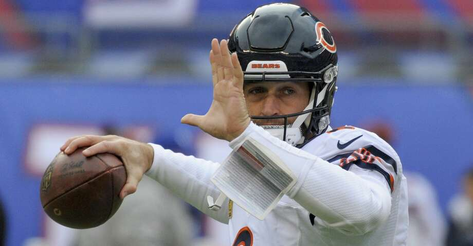 FILE - In this Nov. 20, 2016, file photo, Chicago Bears quarterback Jay Cutler (6) warms up before playing against the New York Giants in an NFL football game, in East Rutherford, N.J. A person familiar with the situation says Cutler, a free agent quarterback, has agreed to terms on a contract with the Miami Dolphins, Sunday, Aug. 6, 2017. Cutler is expected to compete with Matt Moore for the Dolphins' starting job while Ryan Tannehill remains out with a left knee injury that could sideline him for the entire season. (AP Photo/Bill Kostroun, File) Photo: Bill Kostroun/Associated Press
