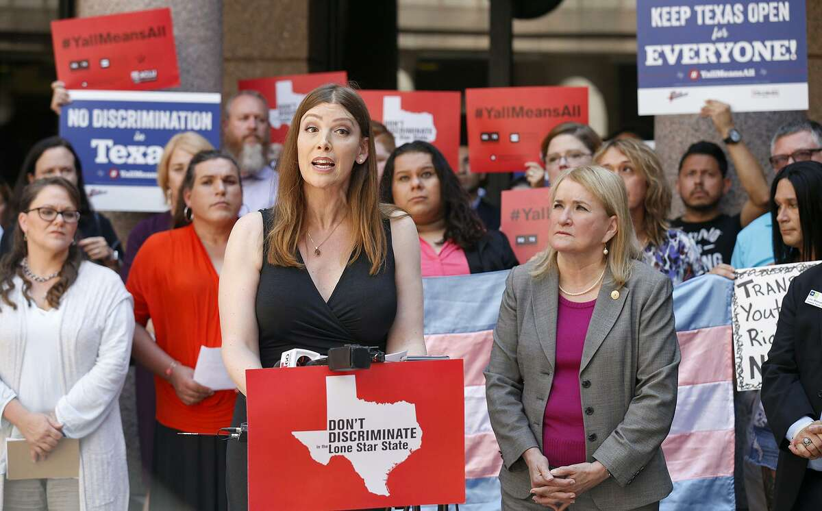 """Transgender woman Ashley Smith (left) speaks as Sen. Sylvia Garcia, D-Houston, (right) and others listen during a news conference against the """"bathroom bills"""" held July 21 at the Texas State Capitol."""
