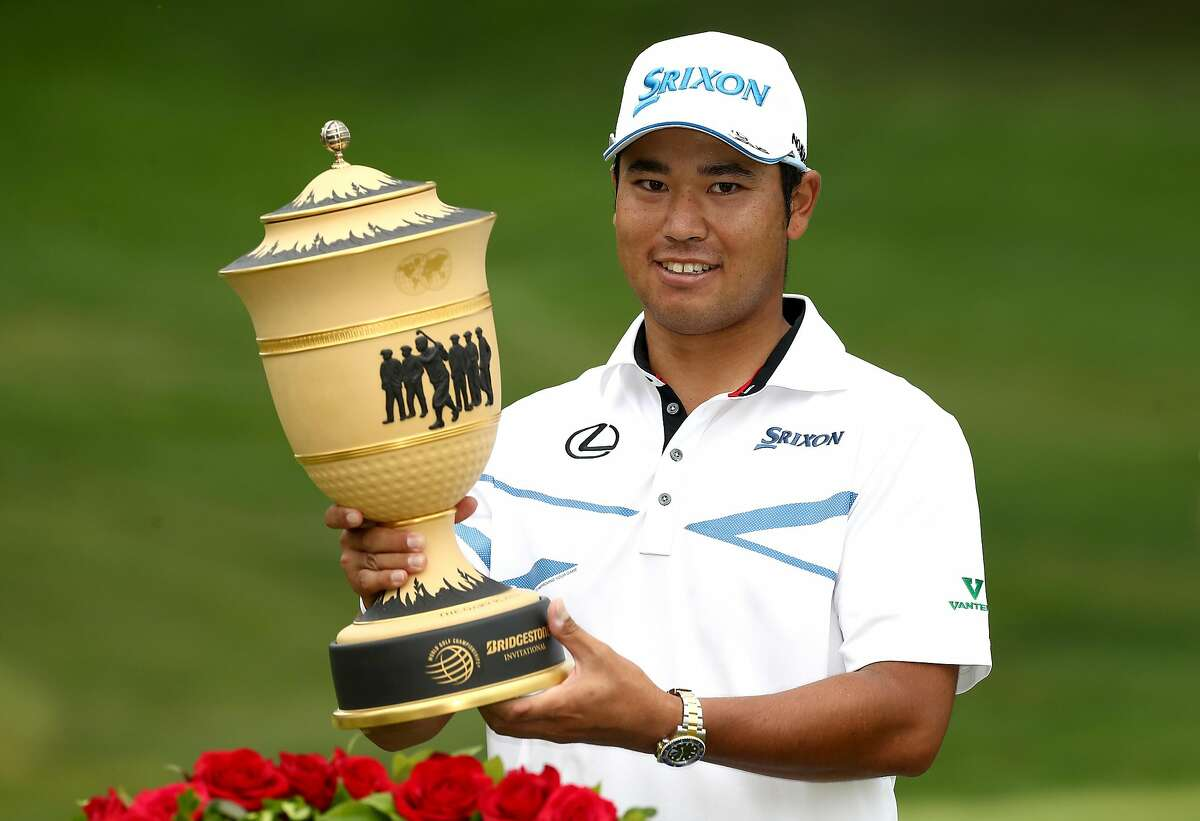 AKRON, OH - AUGUST 06: Hideki Matsuyama of Japan holds the Gary Player Cup after winning the World Golf Championships - Bridgestone Invitational during the final round at Firestone Country Club South Course on August 6, 2017 in Akron, Ohio. Matsuyama finished with a score of -16. (Photo by Gregory Shamus/Getty Images)