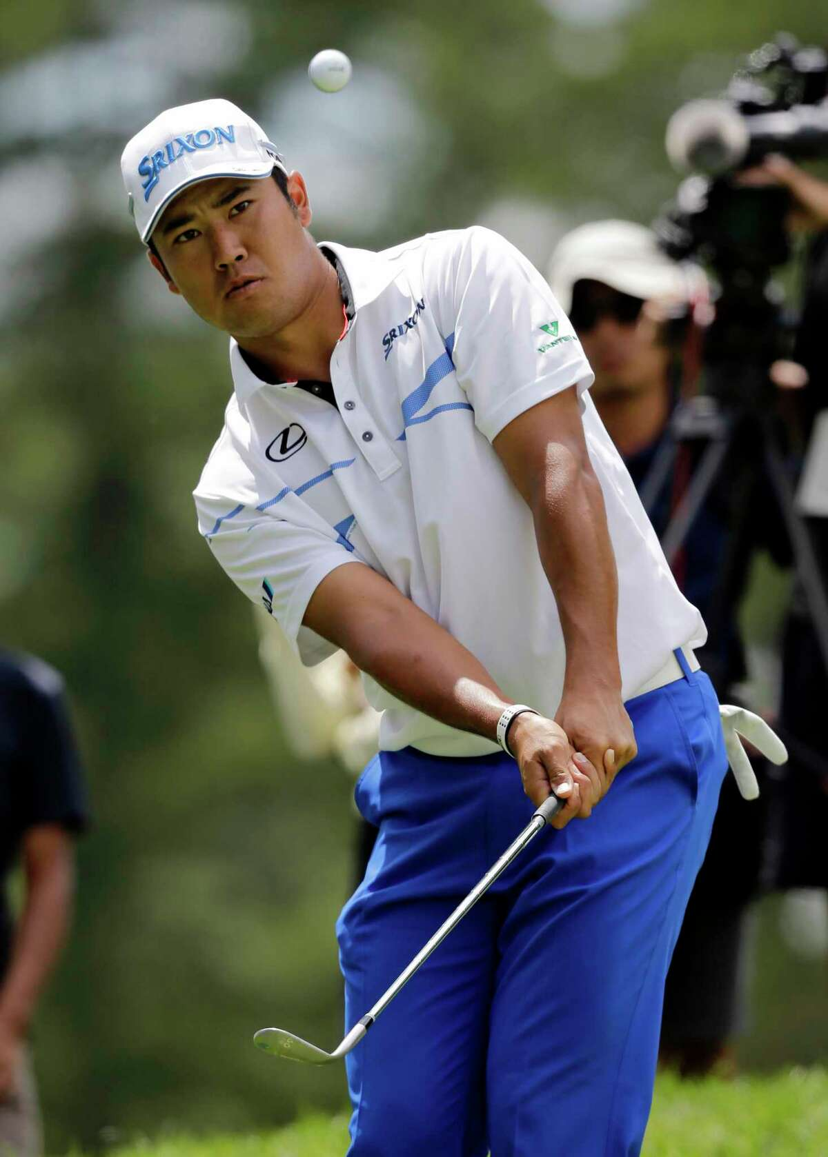 Hideki Matsuyama, from Japan, chips in the ball for an eagle on the second green during the final round of the Bridgestone Invitational golf tournament at Firestone Country Club, Sunday, Aug. 6, 2017, in Akron, Ohio. (AP Photo/Tony Dejak)