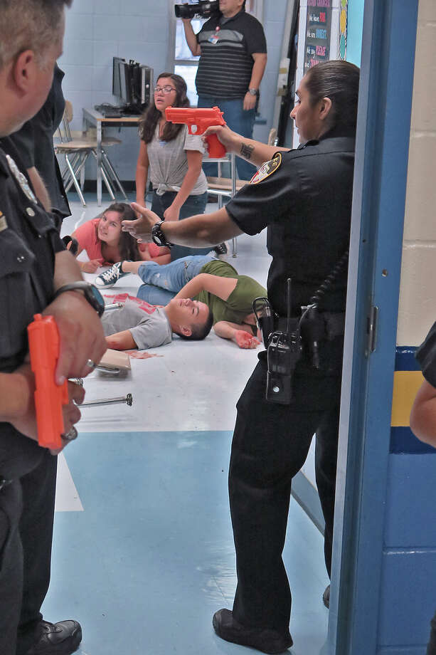 The Laredo Independent School District's Police Department conducted a mock lockdown drill, Friday, August 4, 2017, at L.J. Christen Middle School, as a training exercise in emergency and crisis procedures.  District safety officials will be coordinated the training exercises. Photo: Cuate Santos/Laredo Morning Times