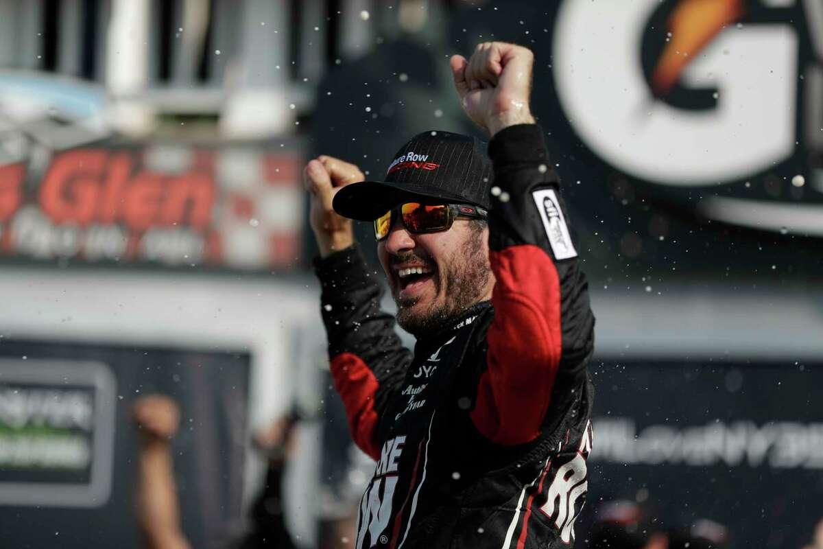 Martin Truex Jr. celebrates after winning the NASCAR Cup Series auto race, Sunday, Aug. 6, 2017, in Watkins Glen, N.Y. (AP Photo/Matt Slocum)