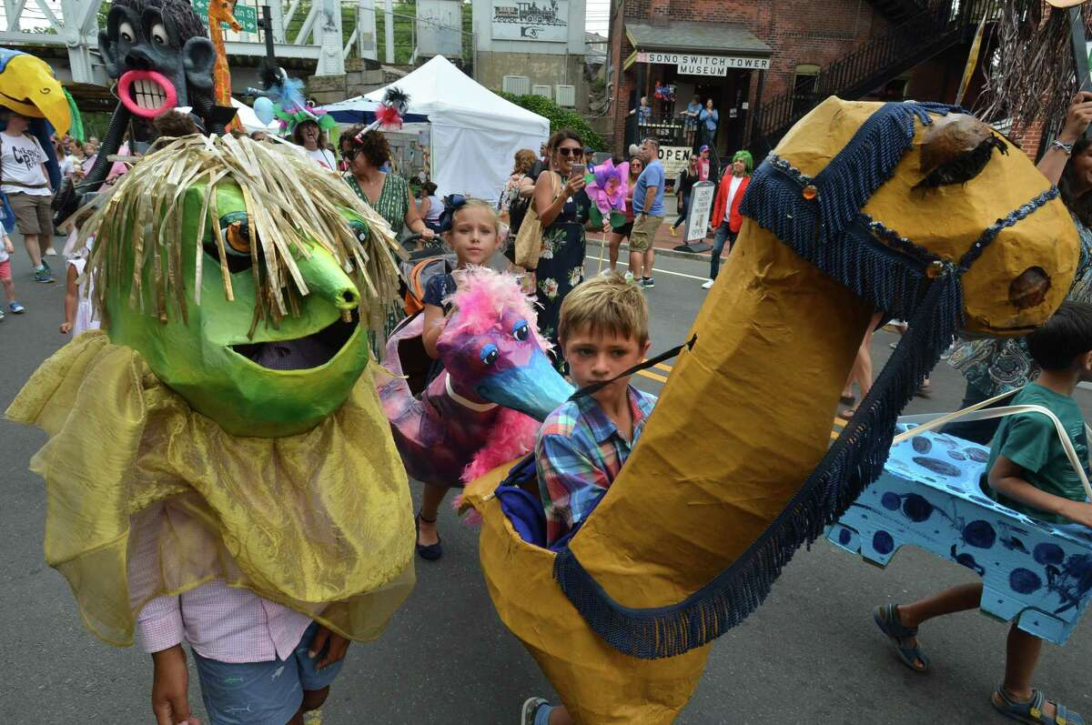 More than 100 puppets of all shapes and sizes march down So. Main St. and Washington St. to crowds of people watching during the SoNo Arts Festival Puppet Parade in Norwalk Conn. on Sunday August 6, 2017.
